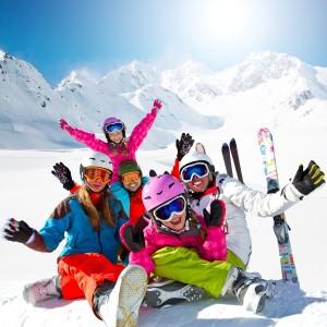 Skiing, winter, snow, skiers, sun and fun - family enjoying wint