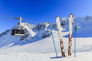 Skiing, winter season - mountains, cable car and ski equipments
